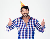Happy man in party hat showing thumbs up Stock Image
