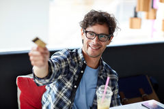 Happy man paying with credit card at cafe Stock Photography