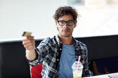 Happy man paying with credit card at cafe Stock Image