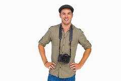 Happy man in peaked cap with camera around his neck Stock Photos