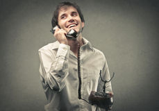 Happy man phoning Stock Photo