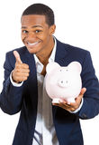 Happy man with piggy savings bank Stock Photo