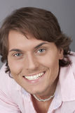 Happy man in a pink shirt Royalty Free Stock Photography