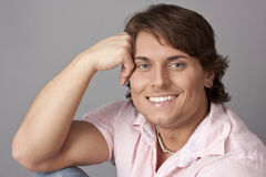 Happy man in a pink shirt Royalty Free Stock Images