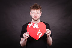 Happy man with plaster heart. Royalty Free Stock Photography