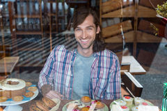 Happy man with a plate of cupcakes Stock Photography