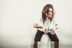 Happy man playing games Stock Images