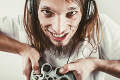Happy man playing games. Playing games. Young smiling cheerful man play on console xbox playstation. Guy with pad joystick Royalty Free Stock Photo