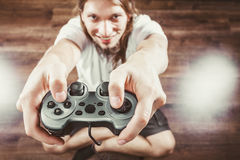 Happy man playing games Stock Image