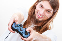 Happy man playing games. Playing games. Young smiling cheerful man play on console xbox playstation. Guy with pad joystick Royalty Free Stock Images