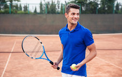 Happy man playing in tennis outdoors. Portrait of a happy man playing in tennis outdoors royalty free stock image