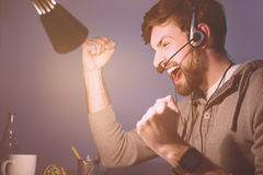 Happy man playing videogame and winning Royalty Free Stock Photo