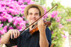 Happy man playing violin outside Stock Photography