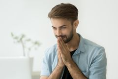 Happy man pleased by online message, good news on laptop. Happy young man pleased by online message or good news on laptop, surprised guy excited by new royalty free stock images