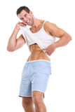 Happy man pointing on abdominal muscles Royalty Free Stock Photos