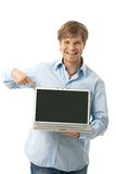 Happy man pointing on blank screen Stock Images