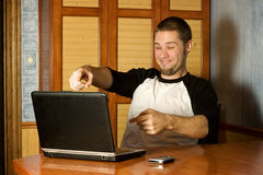 Happy man pointing at computer Stock Photos