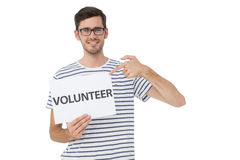Happy man pointing at donation welcome note Stock Photo