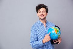 Happy man pointing finger on globe Stock Photography