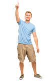 Happy man pointing - full length portrait on white background Royalty Free Stock Photos