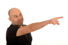 Happy man pointing. Half body portrait of bald middle aged man pointing with finger, white background Stock Photo