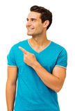 Happy Man Pointing While Looking Away Royalty Free Stock Image
