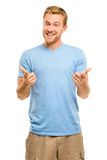 Happy man pointing - portrait on white background Stock Image