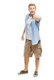 Happy man pointing - portrait on white background Royalty Free Stock Photos