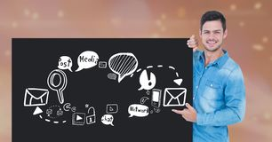 Happy man pointing at social media icons on black placard Stock Photos