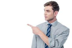 Happy man pointing at something stock image