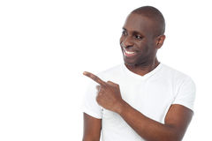 Happy man pointing at something Stock Photos