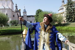 Happy man poses in Rostov kremlin Royalty Free Stock Photography