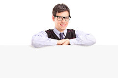 Happy man posing behind a blank panel Royalty Free Stock Photos