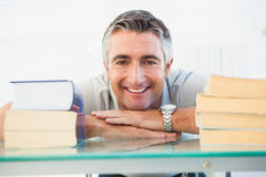 Happy man posing between books Royalty Free Stock Images