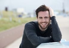 Happy man posing with hand in hair stock photos