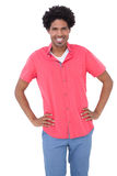 Happy man posing with hands on hips Royalty Free Stock Image