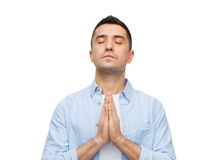 Happy man praying Stock Photos