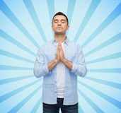 Happy man praying Royalty Free Stock Photo