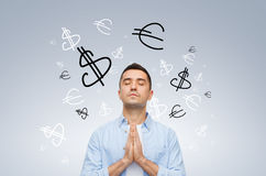 Happy man praying god for money Stock Image