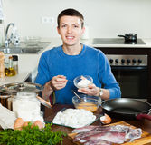 Happy man preparing batter Royalty Free Stock Photography