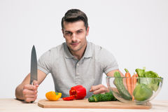 Happy man preparing salad Royalty Free Stock Image