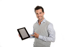 Happy man presenting a text or graphic on tablet screen Stock Images