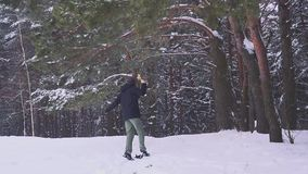 Happy man with a prize in his hands jumps and dancing in the winter forest. Sports victory in competitions. stock footage