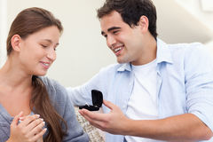 Happy man proposing marriage to his girlfriend Stock Image