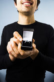 Happy man proposing to you. Smiling young multiracial man presenting an engagement ring Royalty Free Stock Photos