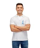 Happy man with prostate cancer awareness ribbon Stock Images