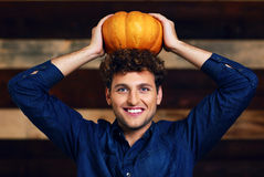 Happy man with pumpkin on head Stock Images