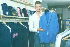 Happy man purchasing jacket Stock Photo