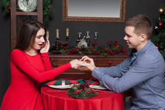 Happy man puts a wedding ring on womans hand Stock Photos