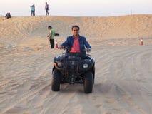 Happy Man Quad Biking in the dunes Stock Photos